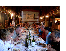 A gathering for a dinner to send seven farmers, two chefs and a student to Terra Madre